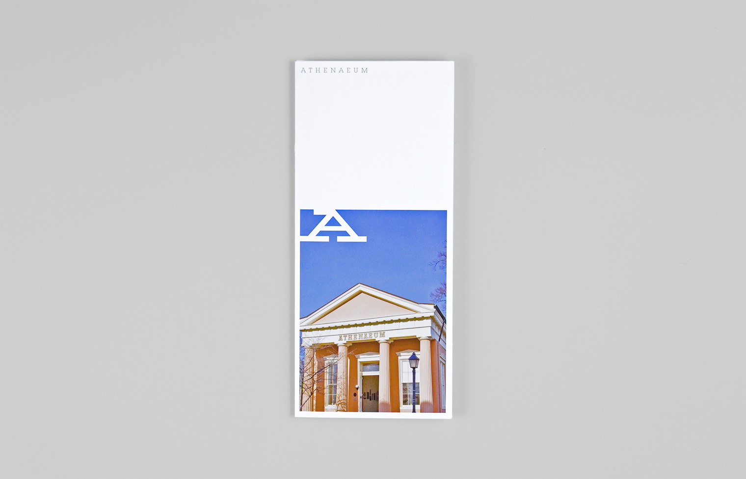 The cover of the Athenaeum's brochure features a photo of the Greek Revival building built in 1852.