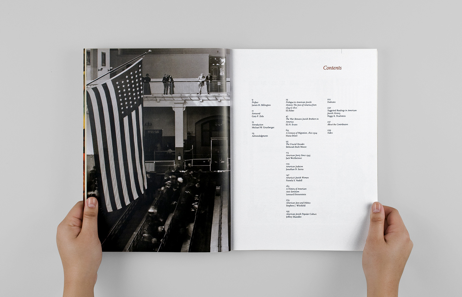The contents page faces a 1912 photograph of an Inspection Room on Ellis Island.