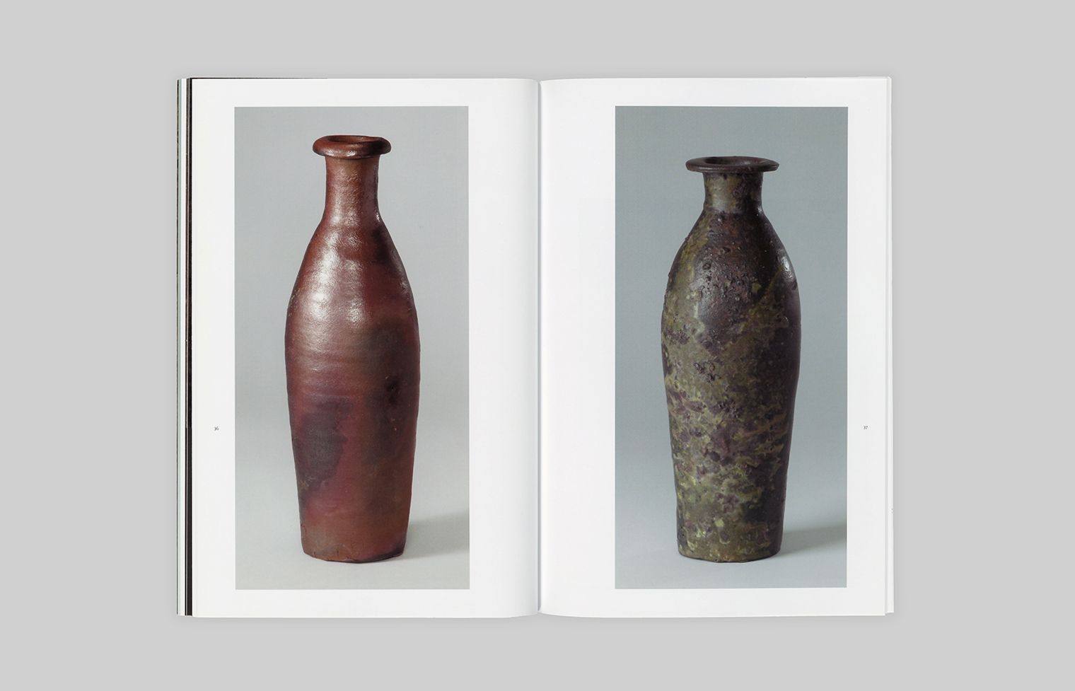 Two stoneware bottles with contrasting glazes.