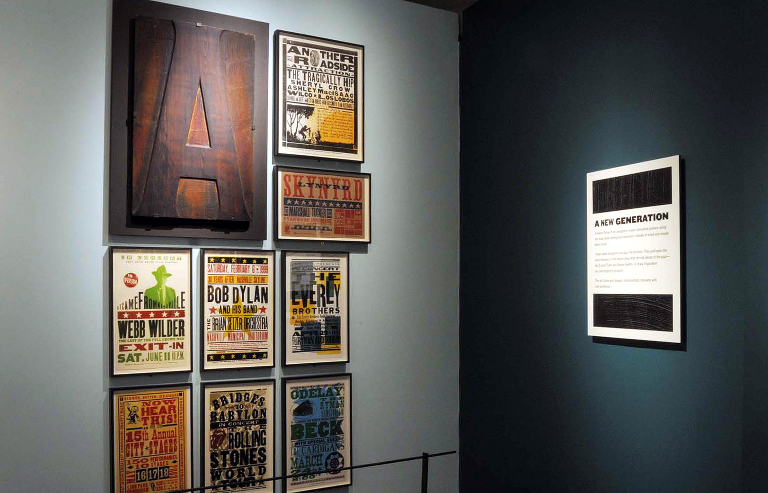 "A massive woodblock ""A"" is surrounded by posters from the 1990s that feature type as their primary image."