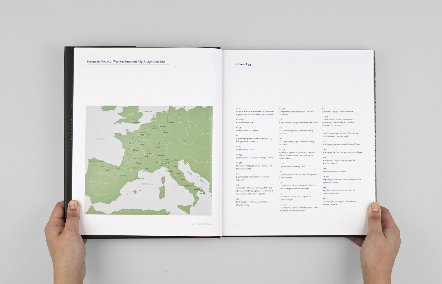 Pilgrimage routes are marked on a map designed by Studio A. It faces a chronology of important events.
